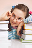 Girl with glasses and a lot of books Stock Photography