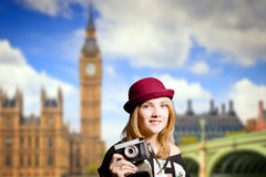 Girl in glasses making photo on London street Royalty Free Stock Images