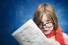 Girl with Glasses and a Newspaper Stock Photos
