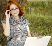 Girl in glasses and notebook Stock Image