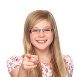 Girl with glasses pointing with index finger. Cute youth girl with glasses pointing on you with her index finger royalty free stock image