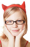 Girl in glasses portrait. Pretty girl in glasses and red horns on white background Stock Photos
