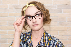 Girl with а glasses. Girl put her glasses in a frame Stock Images