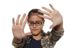 Girl with glasses puts her hands out to protect Royalty Free Stock Photo