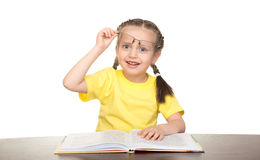 Girl in glasses read book Stock Photography