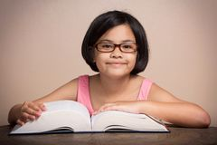 Girl with glasses reading Stock Photos