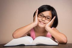 Girl with glasses reading Royalty Free Stock Images