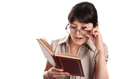 Girl with glasses reading a book Royalty Free Stock Photo