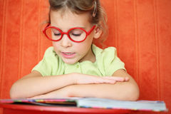 Girl reading a book intently. Royalty Free Stock Images