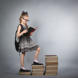 Girl with glasses reading a book Stock Photography