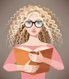 Girl with glasses reading a book Royalty Free Stock Image