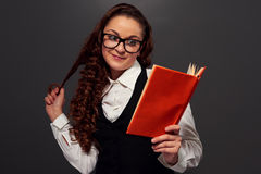 Girl in glasses reading a romance Stock Photo