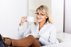 A girl with glasses resting of coffee Stock Photo