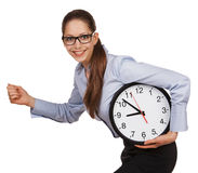 Girl with glasses runs with a clock in his hands Stock Photography