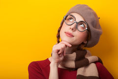 Girl in glasses and scarf Stock Images