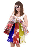 Girl in glasses with shopping bag. Isolated. Royalty Free Stock Photos
