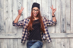 Girl in glasses  show victory sign Royalty Free Stock Images