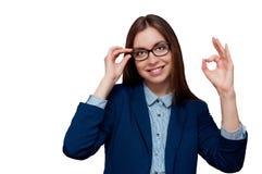 Girl in glasses shows okay Stock Image