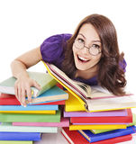 Girl in glasses with stack book . Royalty Free Stock Image