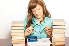 Girl in glasses with stack book Royalty Free Stock Images