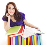 Girl in glasses with stack book . Stock Images
