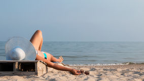 Girl with glasses sunbathes at sunset Stock Photos