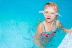 Girl in glasses in the swimming pool Stock Image