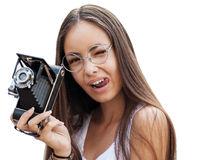 Girl in glasses. Girl in glasses with vintage retro camera having fun playful laughing. Multicultural Asian / Caucasian girl. Shot in a studio Royalty Free Stock Images