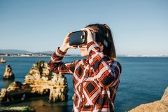 The girl in glasses of a virtual reality. Stock Photography