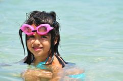 Girl with glasses in the water for swimming Royalty Free Stock Image