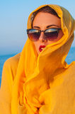 Girl with glasses and a yellow scarf Royalty Free Stock Photo