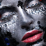 Girl with glitter and rhinestones on her face Royalty Free Stock Image