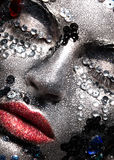 Girl with glitter and rhinestones on her face. Beauty close-up. Stock Images