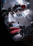 Girl with glitter and rhinestones on her face Royalty Free Stock Photos