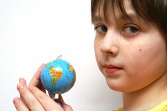 The girl and the globe. On the white background Stock Photography