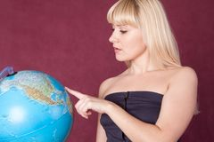 The girl with the globe Royalty Free Stock Photos