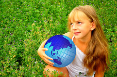 Girl with globe. Green-eyed girl with globe in her hand Stock Image