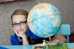 Girl with a globe Stock Images