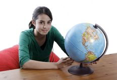 Girl with a globe Royalty Free Stock Photo