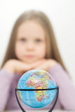 Girl and globe. Travels and Africa. Blue globe and girl as a background Stock Images