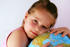 Girl with globe. Girl is holding the world in his hands Stock Images