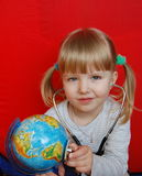 Girl with globe. Small doctor examine the earth Royalty Free Stock Image