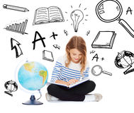 Girl with globe and book Stock Images