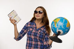 Girl with a globe and the passport stock image