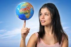 Girl and Globe Stock Image