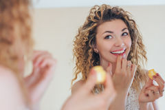 Girl Glossing Clear With The Help Of Finger Royalty Free Stock Images