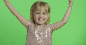 Girl in glossy dress dancing. Happy four years old child. Chroma Key