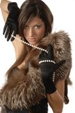 The girl in gloves. The girl in black gloves and fur clothes Royalty Free Stock Images