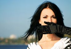 Girl in gloves Royalty Free Stock Photo