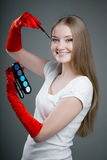 Girl in gloves with brush Stock Photos